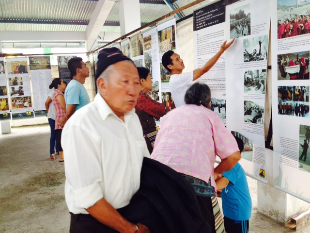The Tibet Museum staff Kunga Phuntsok explaining the exhibition to Tibetans of Kalimpong