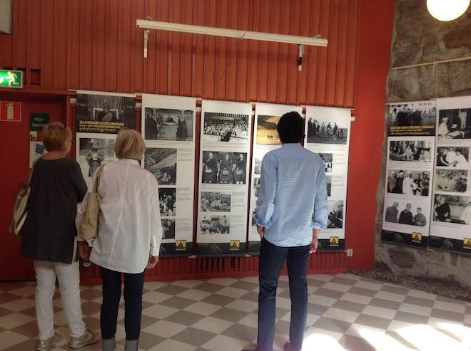 Members of Swedish Tibet Committee viewing the photo exhibition on His Holiness the Dalai Lama's life, 5 July 2015, at Stockholm