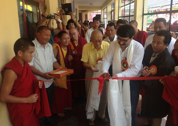 The Chief Guest, Shri. Gobind Singh Thakur, inaugurating Tibet Museum's photo exhibition along with His Eminence Dagpo Rinpoche.