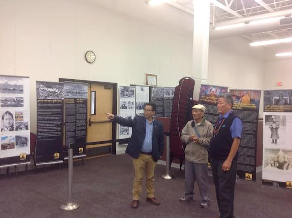 Mr. Tashi Phuntsok, Director of Tibet Museum, explaining the exhibit to a few visitors.