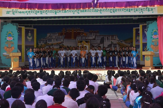 Students singing songs in honour of His Holiness the Dalai Lama's 80th birthday.