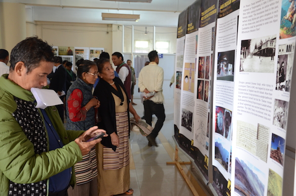 Visitors at the photo exhibition by Tibet Museum.