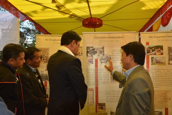 DIIR Secretary Tashi Phunstok describing the panels of the exhibition to Shri. Sudhir Sharma, minister of Himachal Pradesh.