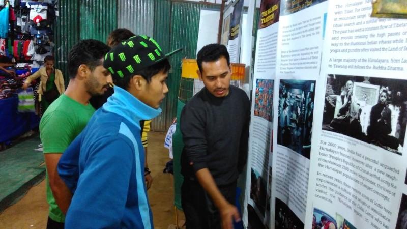 Tibet Museum staff explaining the exhibit to visitors.