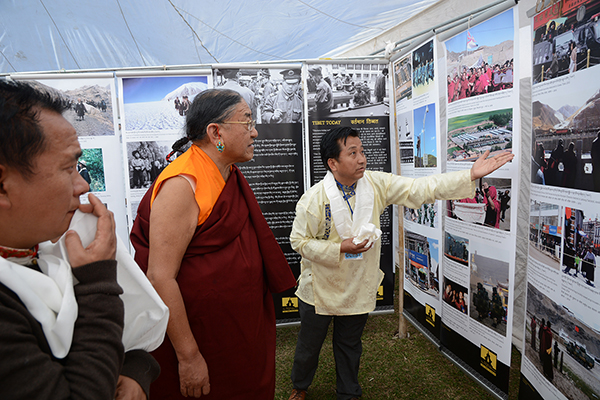 Mr Tashi Phuntsok, Director of Tibet Museum explaining the exhibit to Chief Guest His Eminence the Sakya Trizin, head of Sakya school of Tibetan Buddhism, at Tibet Museum's photo exhibition at Tso Pema, Rewalsar