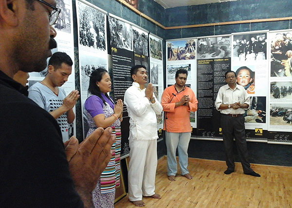 Organising members and visitors reciting Tibetan Universal Peace Prayers
