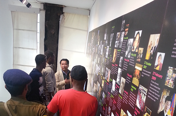 The Tibet Museum Director Mr. Tashi Phuntsok briefing some member of the Zimbabwean cricket team  on Tibet's history and current situation inside Tibet