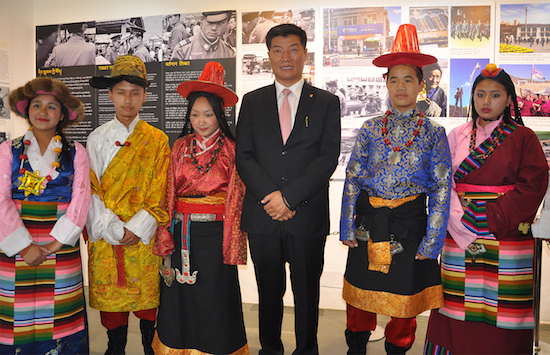 Sikyong Dr Lobsang Sangay with a group of Tibetan school children in traditional Tibetan costumes