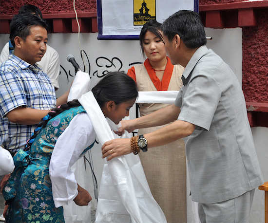 DIIR Secretary Sonam Norbu Dagpo offering ceremonial Tibetan scarves to a participant as a token of gratitude, 20 May 2016.
