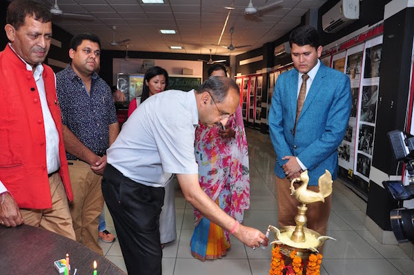 Mr. Anil Vasudeva, the Mayor of Pathankot, initiating the second day of exhibition.