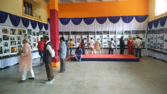 Visitors at the photo exhibition showcased by Tibet Museum at Hubli, Karnataka