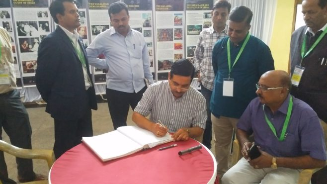 Shri Pralhad Joshi, Lok Sabha MP from Dharwad, the Chief Guest writing on visitor's comment book.