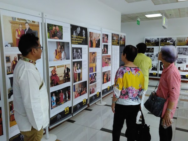 Visitors at the photo exhibition showcased by Tibet Museum on 'His Holiness the Dalai Lama's life.'