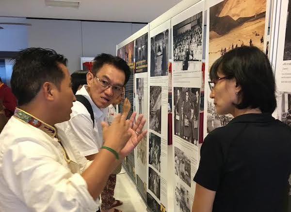 Director of Tibet Museum Mr Tashi Phuntsok describing exhibition at Poh Ming Tse Temple, Singapore