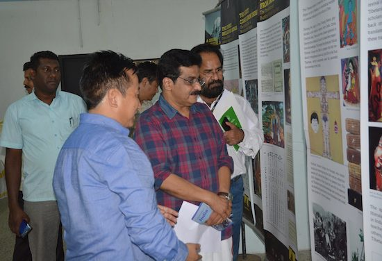 Chief guest Dr M K Muneer, MLA and former Minister for Social Welfare being guided through the photo exhibition by Mr Tashi Phuntsok, Director of Tibet Museum, 11 September 2016.