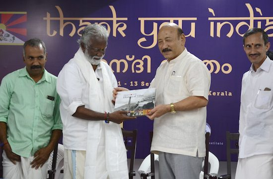 Shri R K Khrimey, National convener for Core Group for Tibetan-Cause presenting a copy of 'Glimpses of the History of Tibet', an illustrated book on Tibet's history to the chief guest, Shri Kummanam Rajashekaran, President of BJP Kerala State unit, 13 Sept 2016.