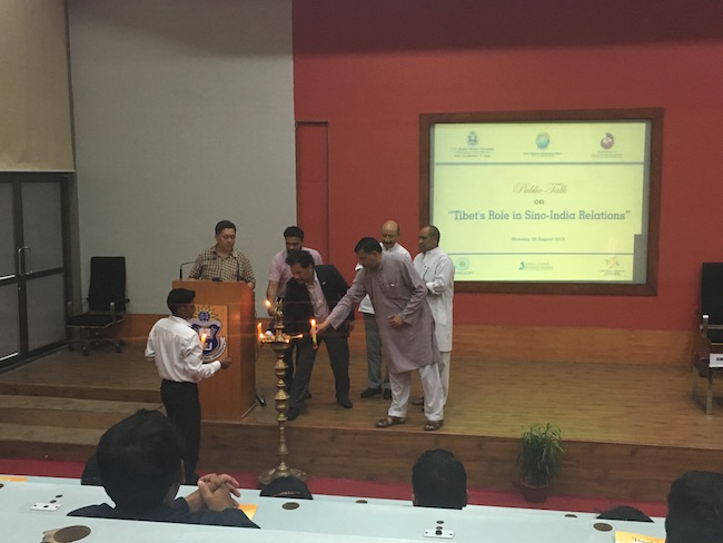 Deputy Director of Tibet Policy Institute along with the distinguished speakers lighting the auspicious butter lamp before the talk.