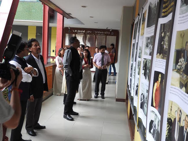 The Vice Chancellor and faculty of O P Jindal University touring the photo exhibition showcased by Tibet Museum on the 'life of His Holiness the Dalai Lama' and 'India-Tibet Relations.' Photo credit: Buchung Dhargyal, TPI
