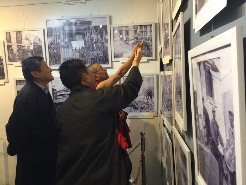 Tashi Phuntsok, Director of the Tibet Museum explaining a photograph to Kalon Karma Gelek Yuthok during the inaugural ceremony of the 'Revisiting Cultural Revolution in Tibet' exhibition on October 28, 2016/Phayul Photo: Kunsang Gashon