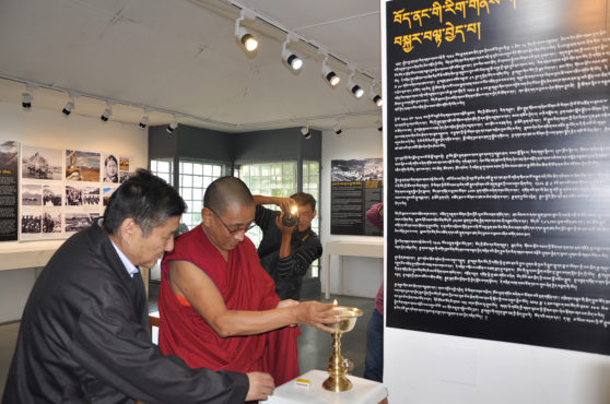 Kalon Karma Gelek Yuthok lighting the auspicious Tibetan butter lamp during the inauguration of the photo-framed exhibition cum panel discussion at the Tibet Museum with Secretary Sonam Norbu Dagpo, DIIR. Photo/Tenzin Phende/DIIR