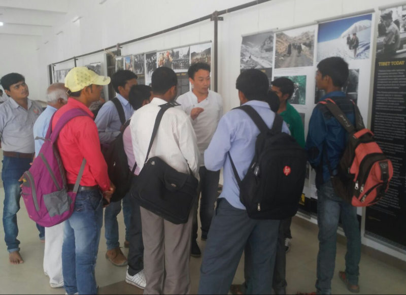 The Tibet Museum's staff explaining the exhibition to the visitors.