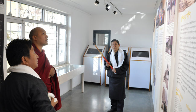 Gyalwang Karmapa Rinpoche viewing a panel on exhibition at Tibet Museum, 14 December 2016.