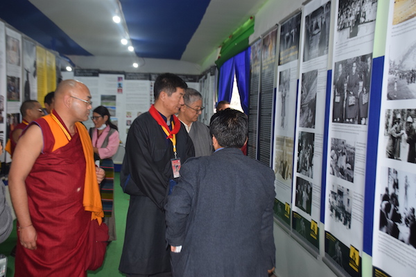(L-R) Speaker Khenpo Sonam Tenphel, Sikyong Dr Lobsang Sangay, Chief Justice Commissioner Mr Kargyu Dhondup being led through the photo panels by Director Mr Tashi Phuntsok during the exhibition in Bodh Gaya on 2 January 2017.
