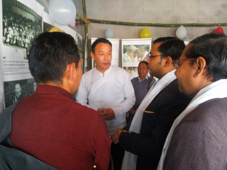 Staff of Tibet Museum explaining exhibition to chief guest.
