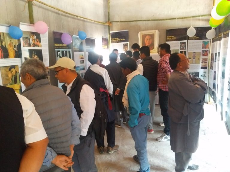 Tibetan, local Indians, tourists watching at the exhibition.