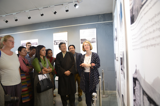 Dr Emma Martin explaining the exhibits to Secretary Sonam Norbu Dagpo and other guests, 14 April 2017.