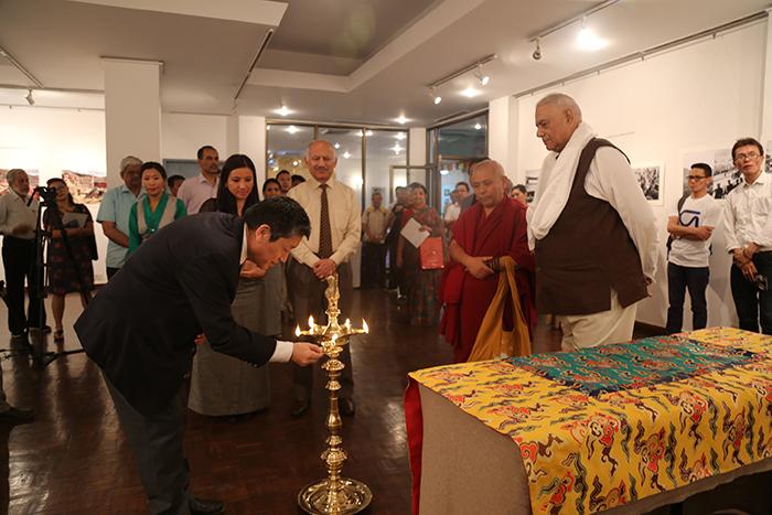Representative of His Holiness the Dalai Lama in New Delhi, Dhongchung Ngodup Dorjee lights the lamp at the inauguration of the Photo Exhibition on 'Revisiting Cultural Revolution in Tibet.'  Photo @ Namgyal Tsewang, DIIR