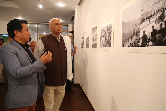 Tibet Museum Director Tashi Phuntsok guides Shri Yashwant Sinha at the inauguration of Photo Exhibition on 'Revisiting Cultural Revolution in Tibet.'  Photo @ Namgyal Tsewang, DIIR