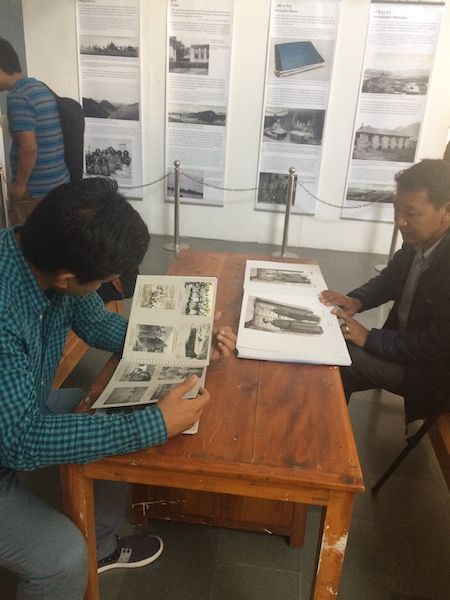 Visitors going through the unseen photographs taken during the 1904 Younghusband expedition to Tibet at the Tibet Museum on April 14, 2017. Photo Tenzin Monlam