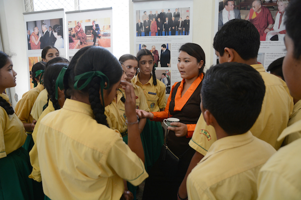 Tibet Museum staff Ms. Tenzin Ingsel explaining the exhibits to the visitors, 17 June 2017. Photo/Tibet Museum