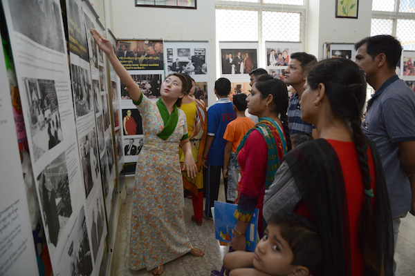 Tibet Museum staff Ms. Yeshi Wangmo explaining the exhibits to the visitors, 17 June 2017. Photo/Tibet Museum