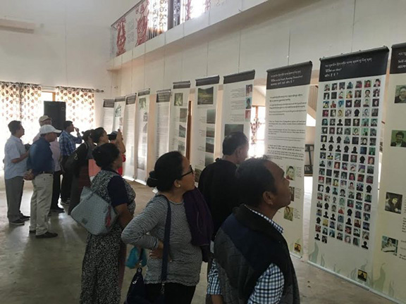 Spectators viewing the exhibits on 'Biography of His Holiness the Dalai Lama' and 'Why are Tibetans turning to Self-Immolations?'