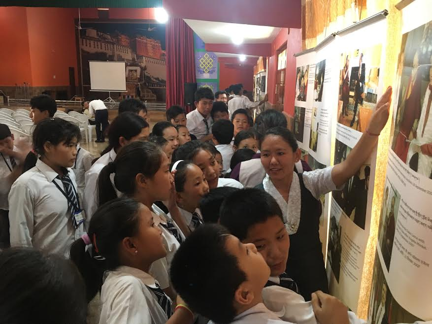 Tibet Museum staff Ms. Tenzin Youtso explaining the exhibits to the students. Photo/Tibet Museum