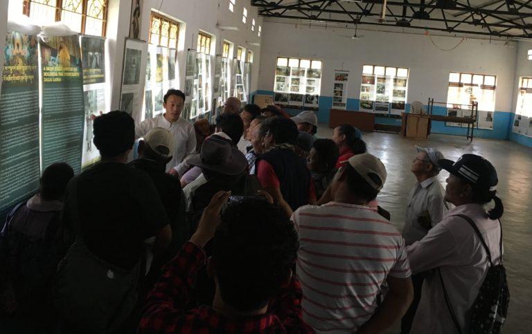 Museum staff, Tenzin Ramjam explaining the exhibits to visitors.