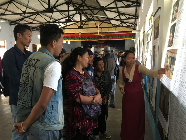 Museum staff, Tenzin Youtso explaining the exhibits to visitors.
