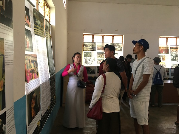 Museum staff, Tenzin Ingsel explaining the exhibits to visitors.