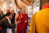 His Holiness the Dalai Lama looking at a photo exhibition on display in the meeting room for the dialogue with Russian scientists in New Delhi, India on August 7, 2017.Photo/ArtemSavateev