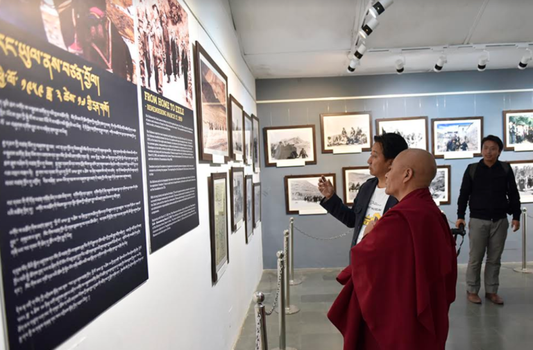 Director of Tibet Museum Tashi Phuntsok showing the exhibits to Deputy Speaker Acharya Yeshi Phuntsok at the Tibet Museum, Mcleod Ganj. Photo/Tenzin Phende/DIIR