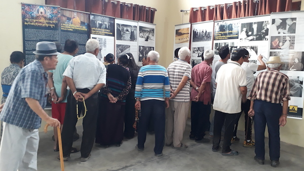 Visitors at The Tibet Museum's exhibition at Paonta Cholsum Tibetan settlement in Himachal Pradesh.