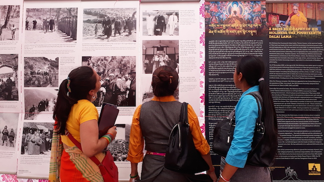Tibetans and local Indians visiting Tibet Museum's photo exhibition. Photo/Tibet Museum